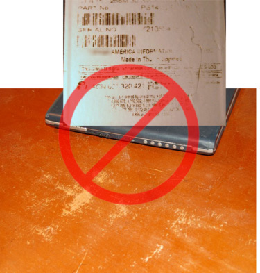 Scratches desktop and scratched computer label with universal 'no' symbol through it